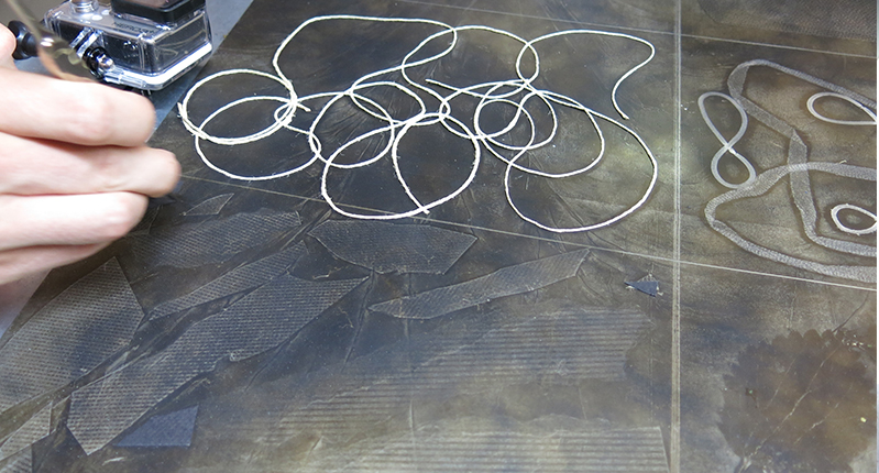string on a metal plate