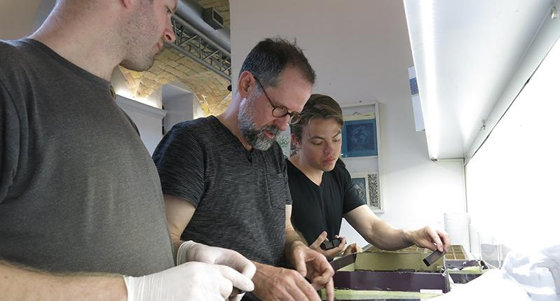 three men working together