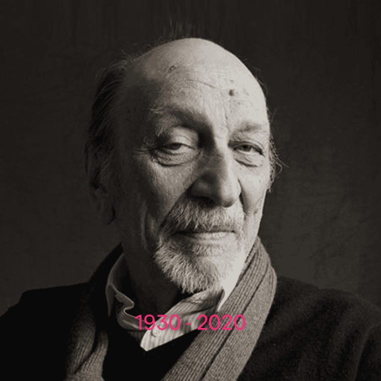 B&W portrait of Milton Glaser in black jacket and grey scarf 1930 - 2020
