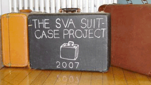 suitcases with the SVA suitcase project 2007 logo on one suitcase