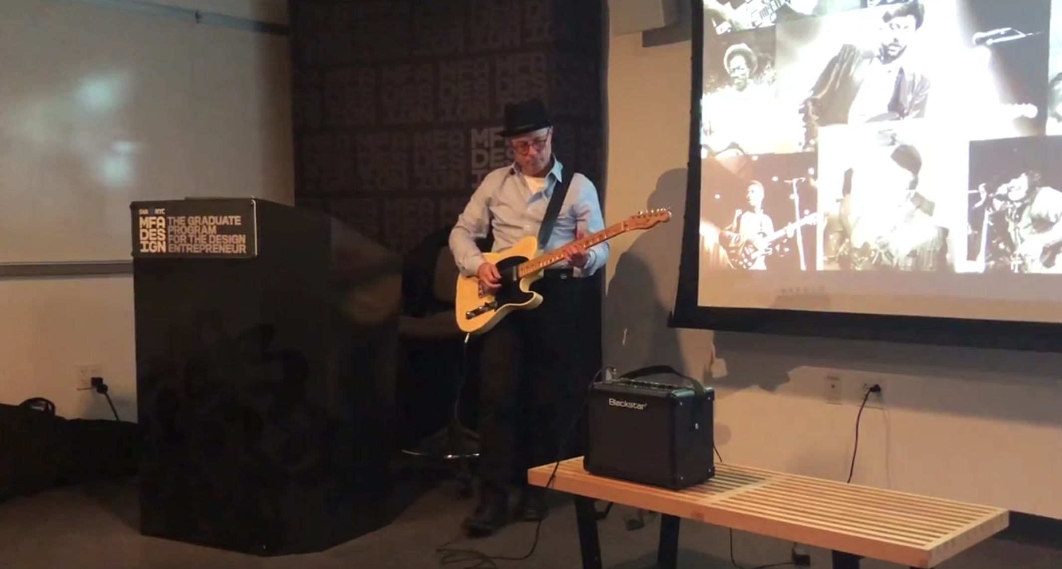 image of Ken Carbone playing guitar