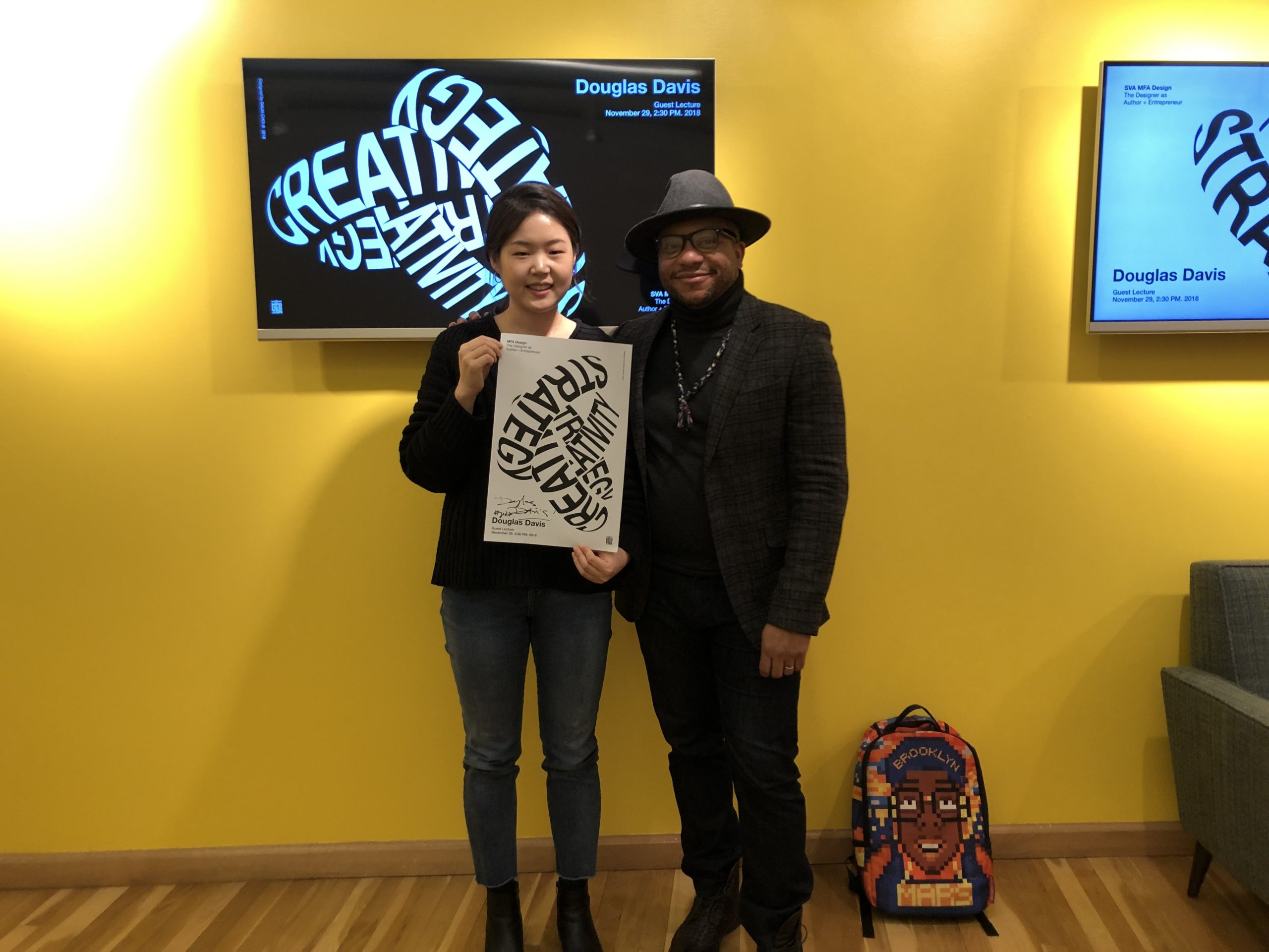 Douglas Davis with a student holding poster