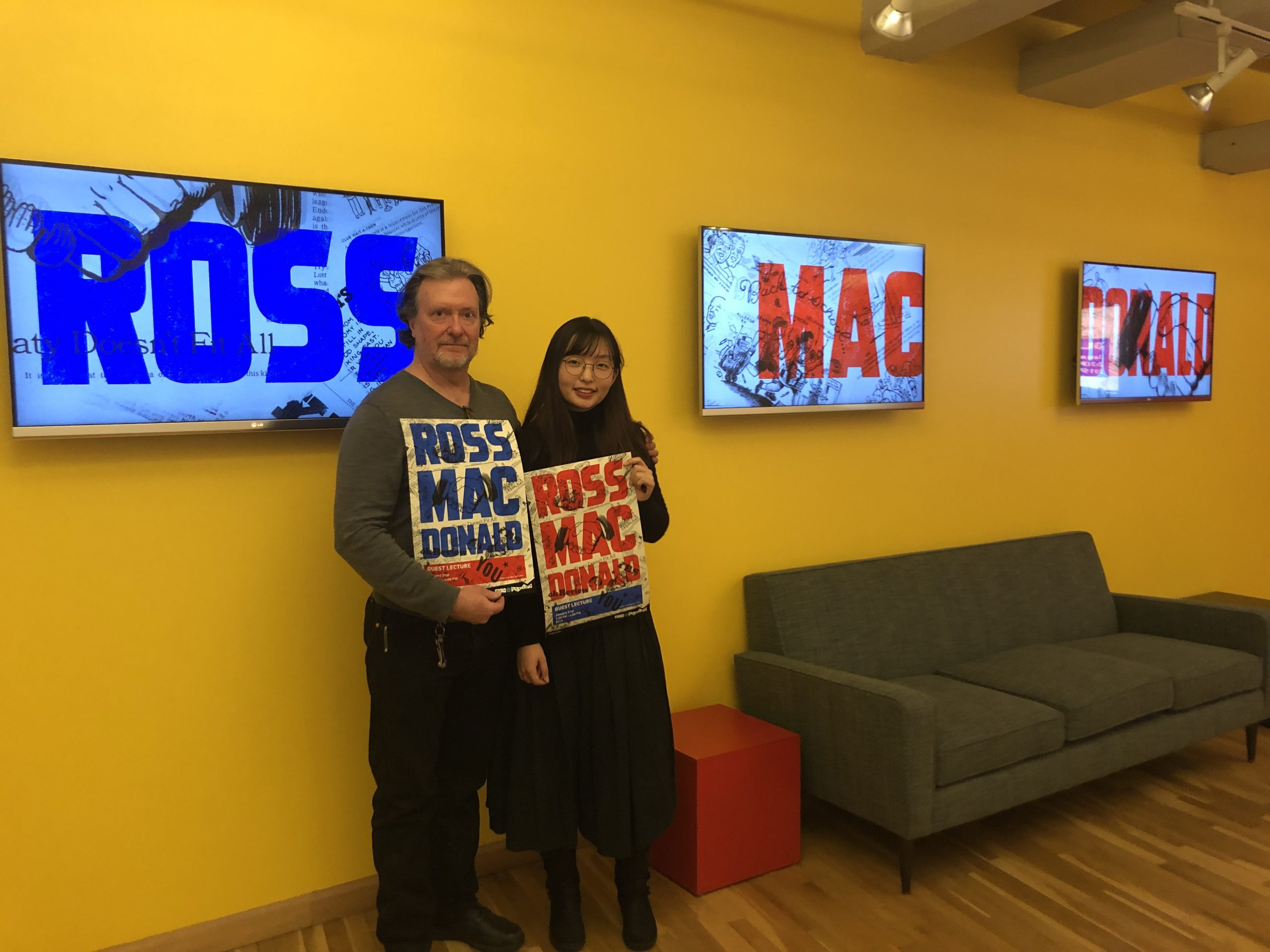 Ross Mac Donald and a student with a poster
