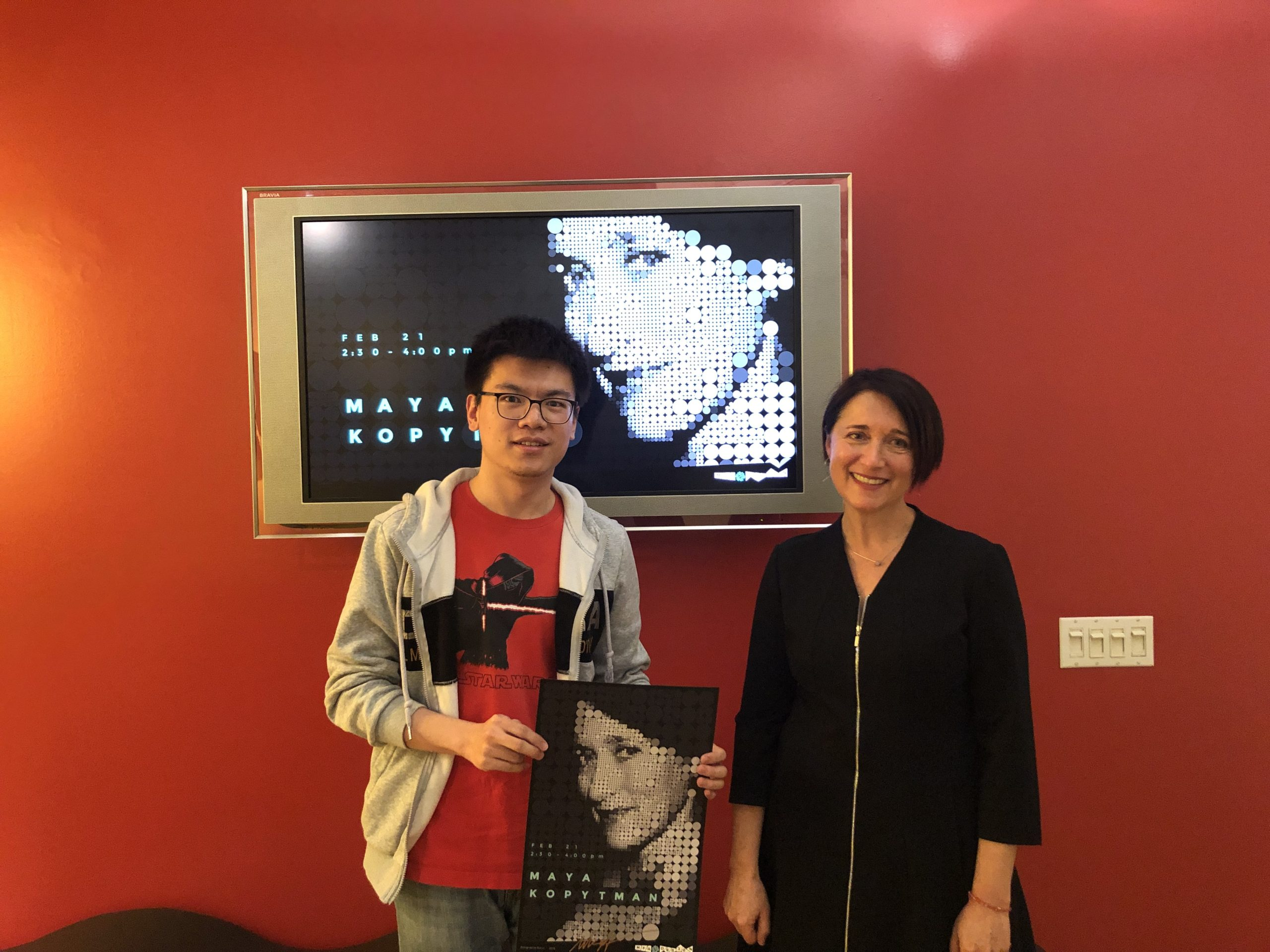 Maya Kopytman's guest lecture with a student holding a poster