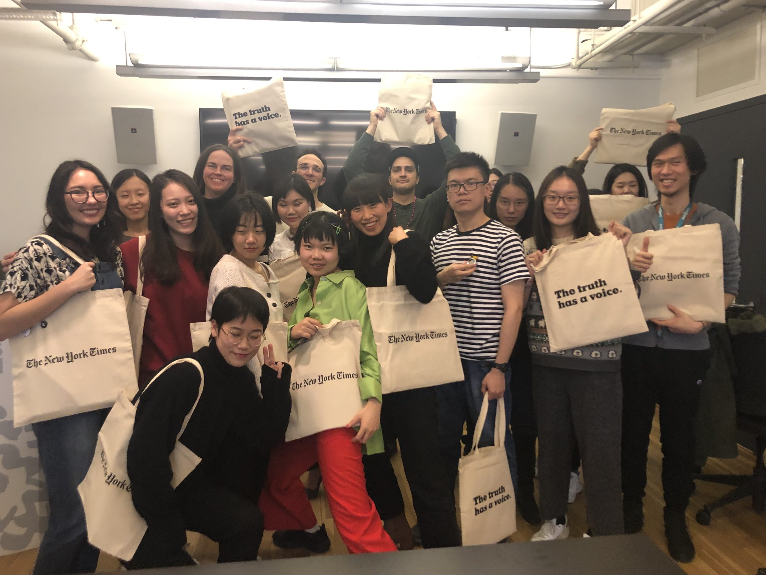 group photo with students holding eco bags