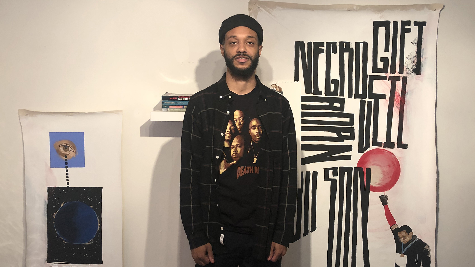 Mitchell R Johnson in front of typography painting piece