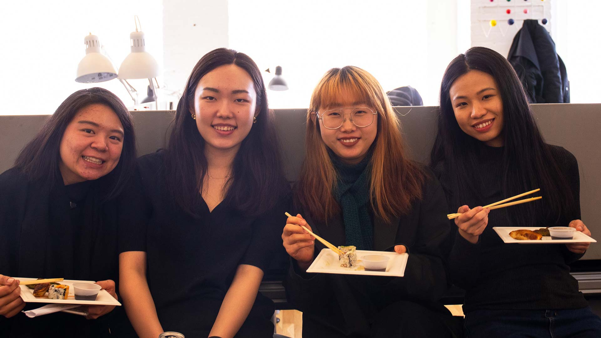 four students from venture 19 with sushi