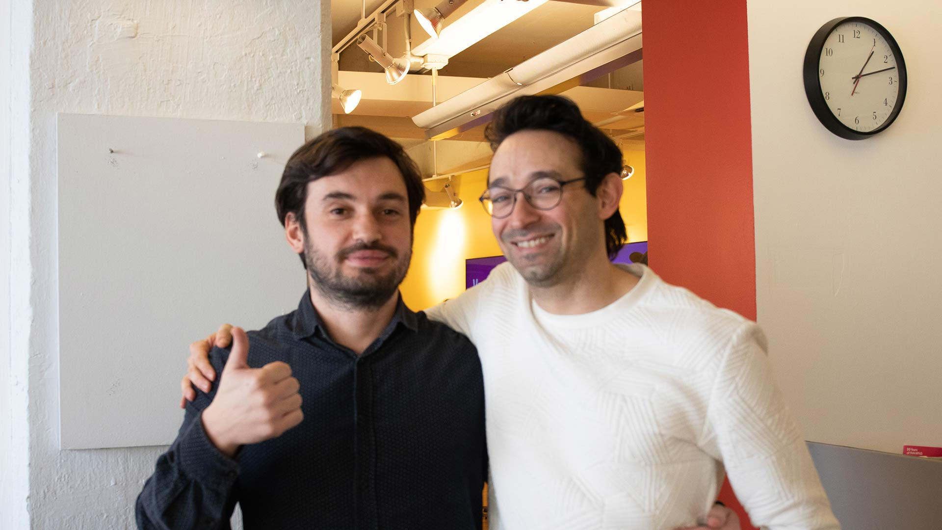 photo of two man with thumbs up