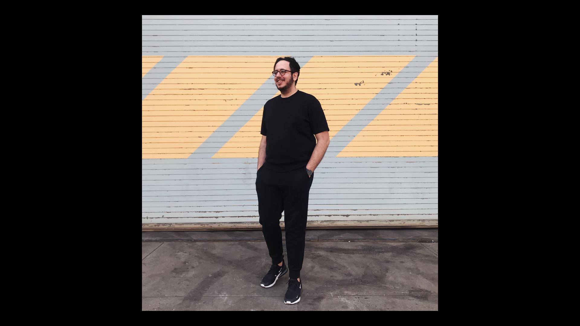 Sabri Akin posing in black clothes and black glasses