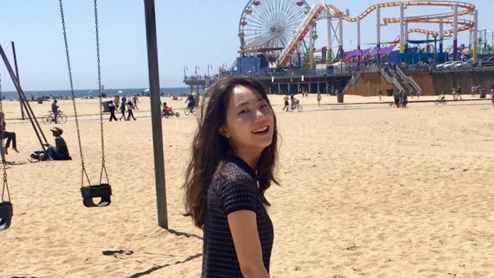 picture Eunji Kim smiling at the beach