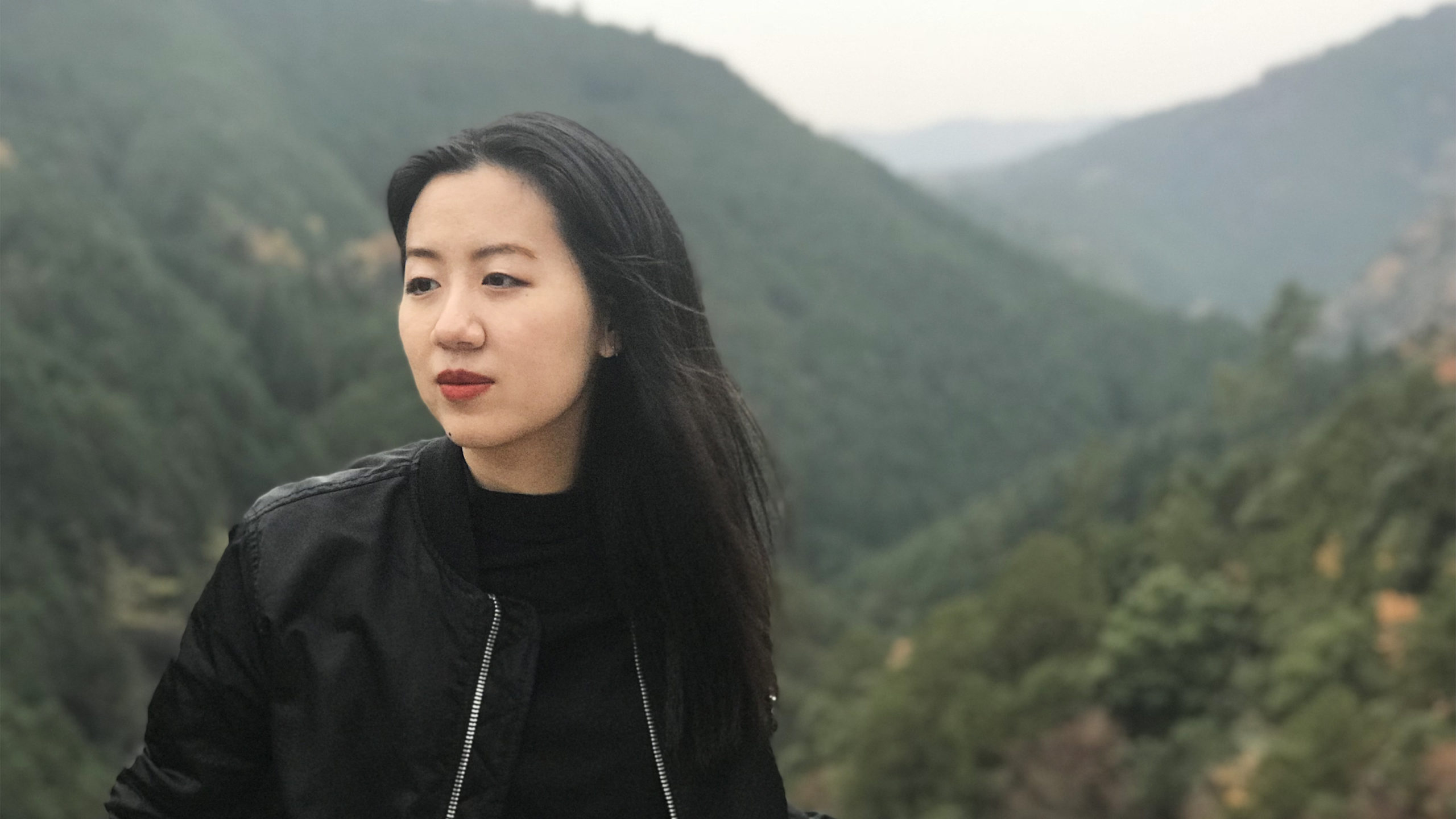 portrait of Tiffany Pai with hills in the background