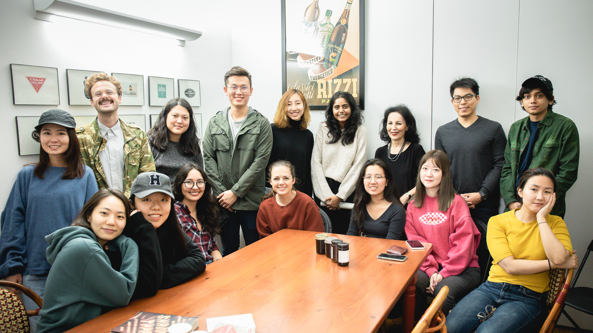 students pose with Louise Fili in her studio