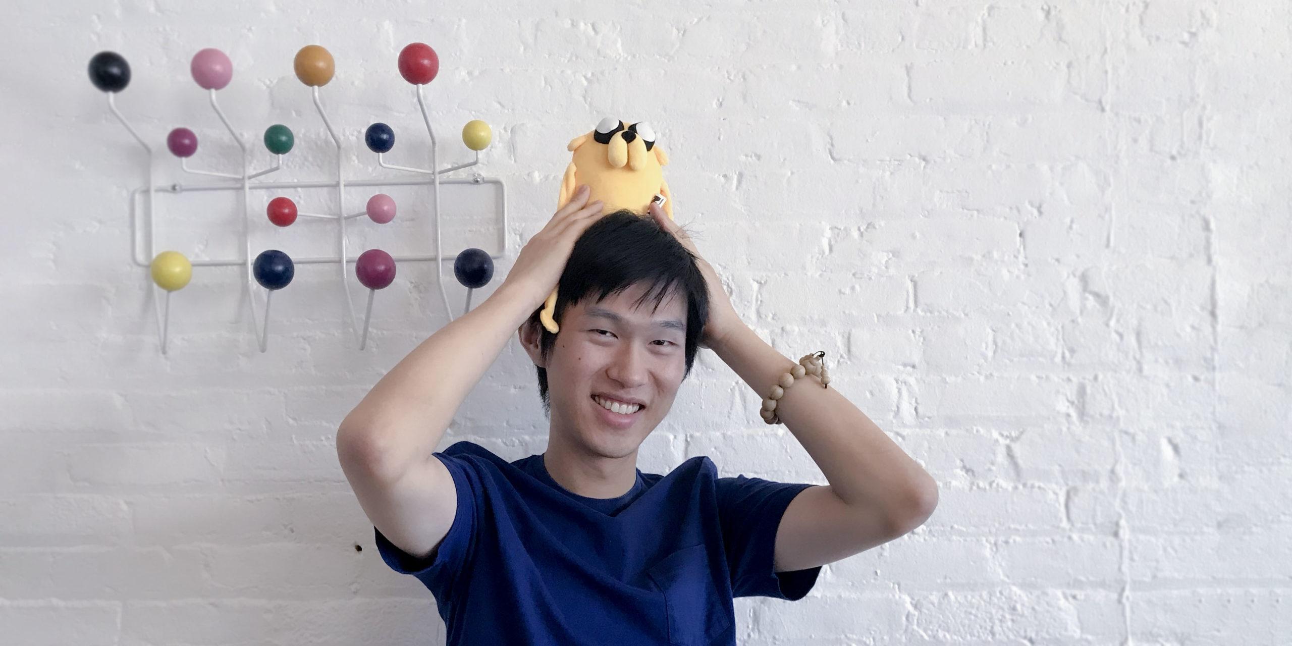 Yingda Xu poses with plush toy