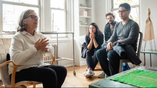 Maira Kalman in her apartment with students