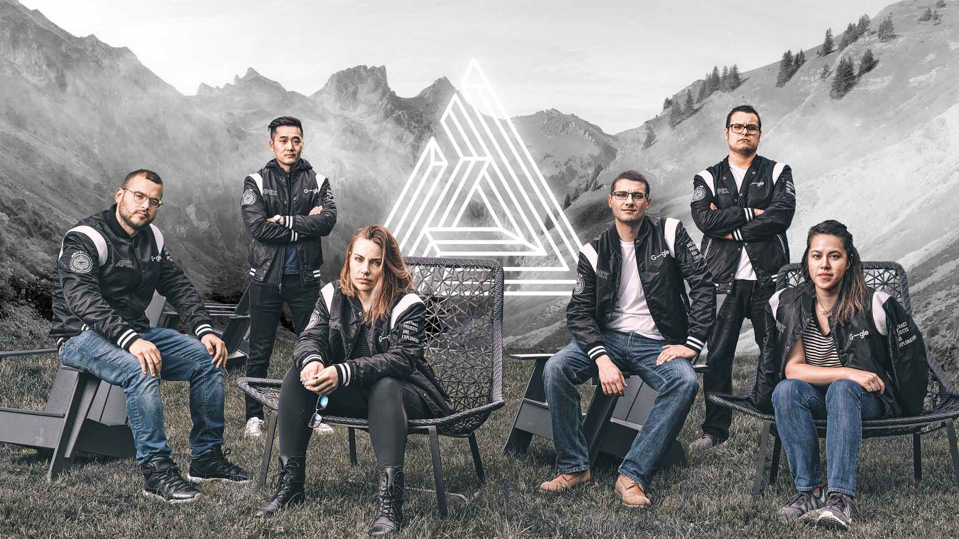 6 men and women in black jackets outdoors in front of a mountain
