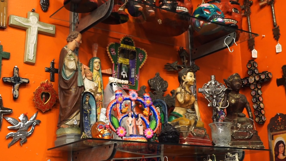crosses and icon ona shelf with orange backdrop