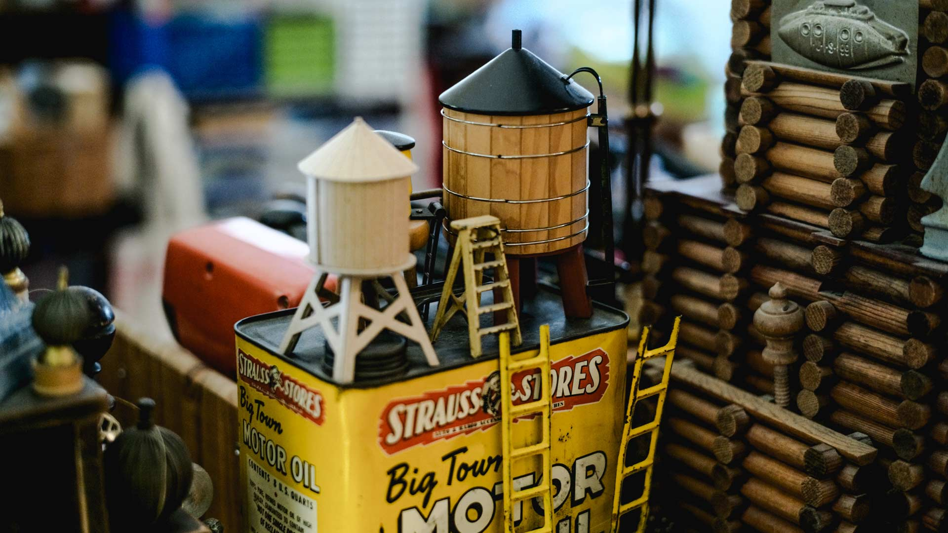 dorothy globus studio miniature water cooling towers on vintage motor oil can