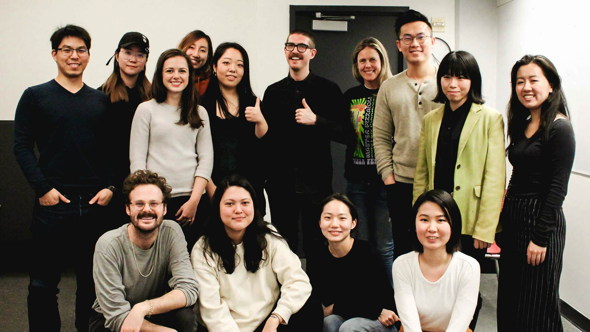 SVA MFA Design students posing for a photo with Jesse Reed in the classroom