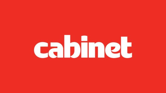 Cabinet logo, white type on red background