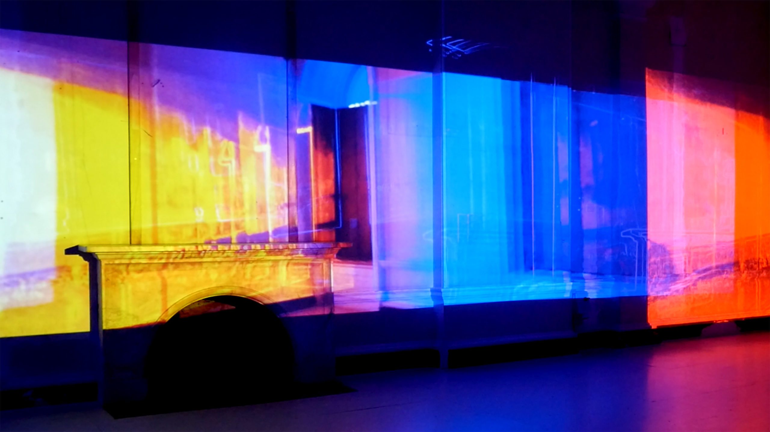 projection of an interior with a fireplace covered in the colors of the spectrum