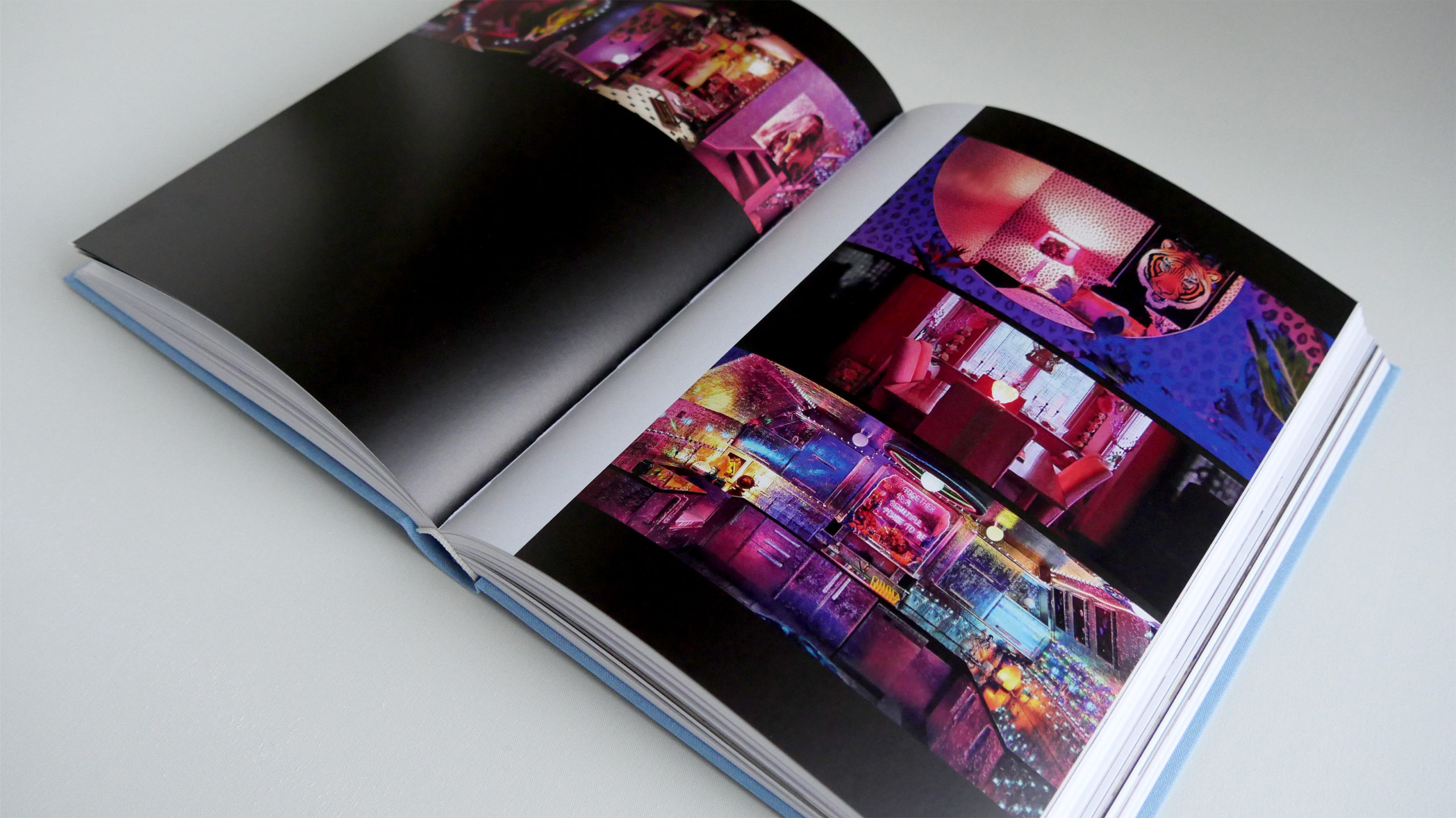 Uchronia book opened to a colorful collaghe of photos