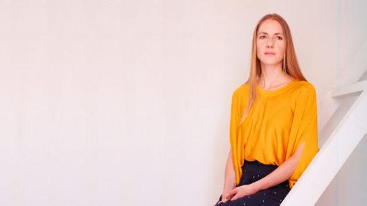 portrait of Helga Schmid wearing yellow blopuse