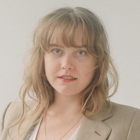 Portrait of Krista Lewis in beige jacket