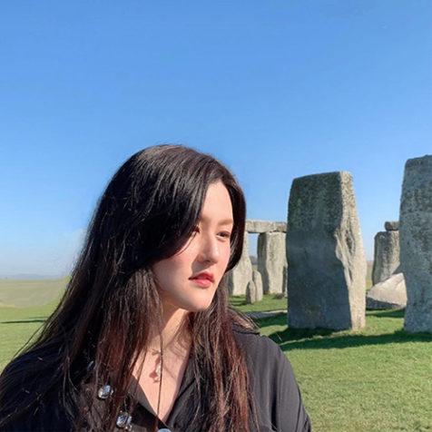 Shuhan Lu in black top at Stone Henge