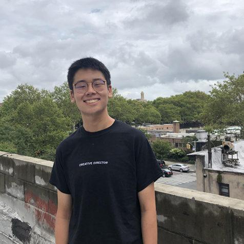ezra lee in black tee on rooftop