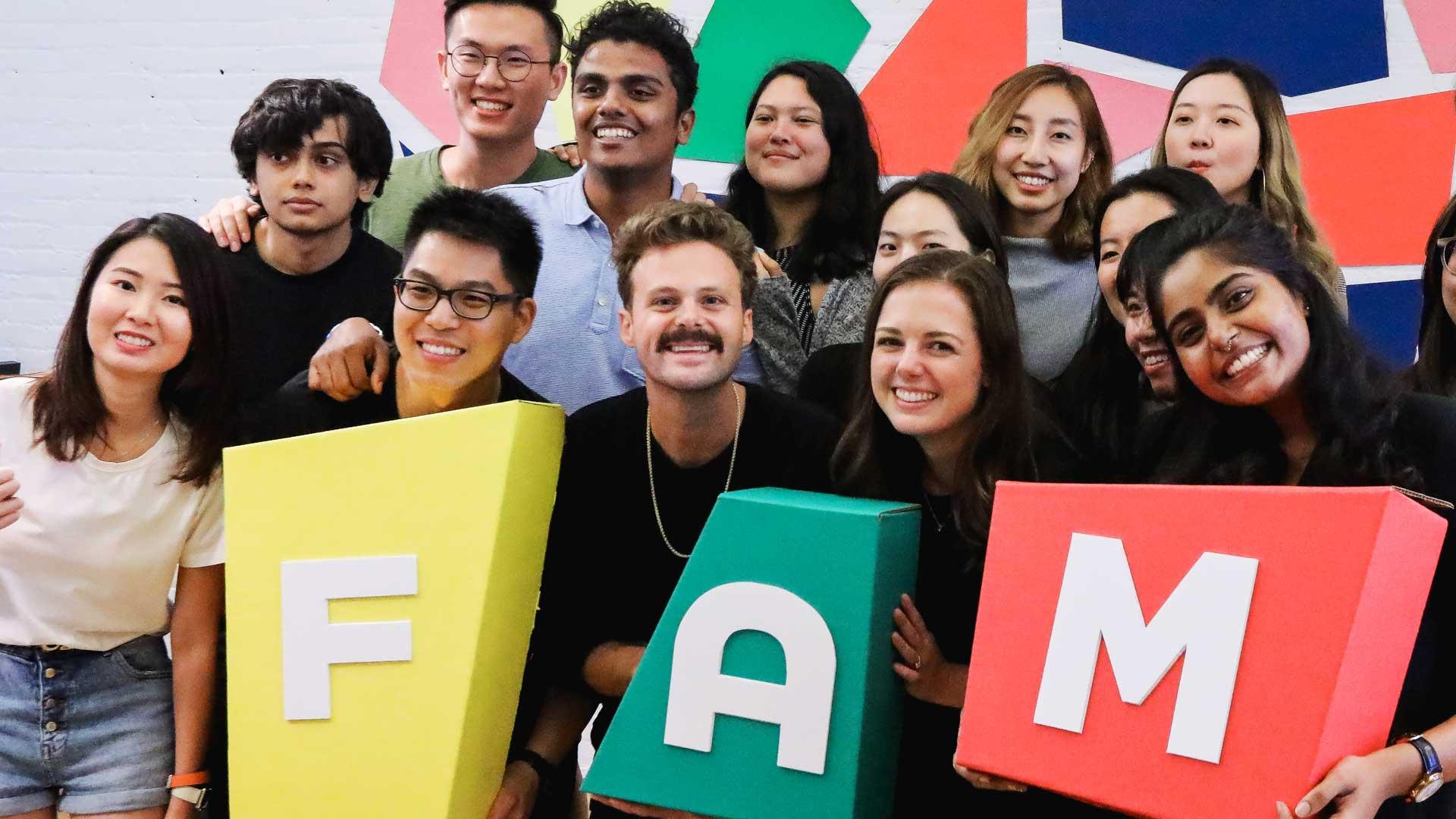 MFA Design students holding FAM