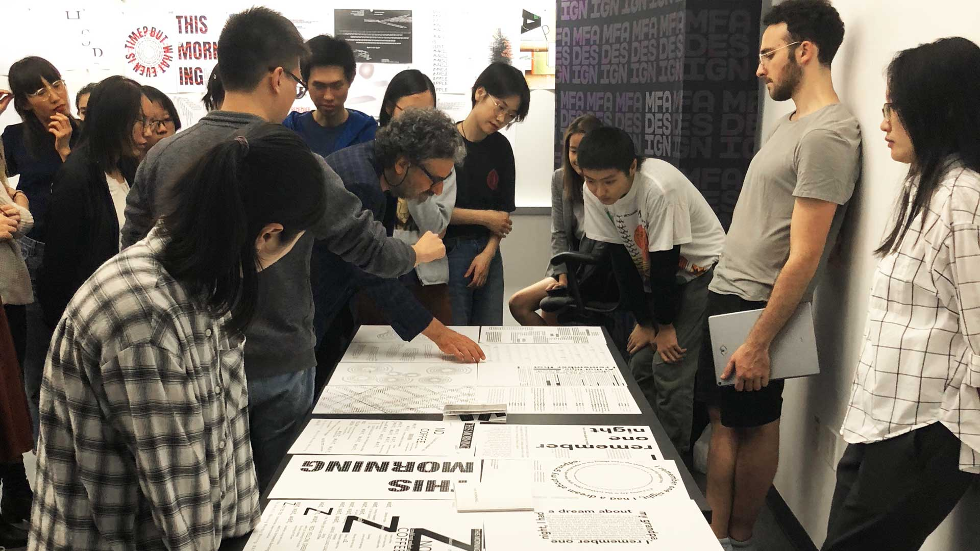 students viewing design work in classroom