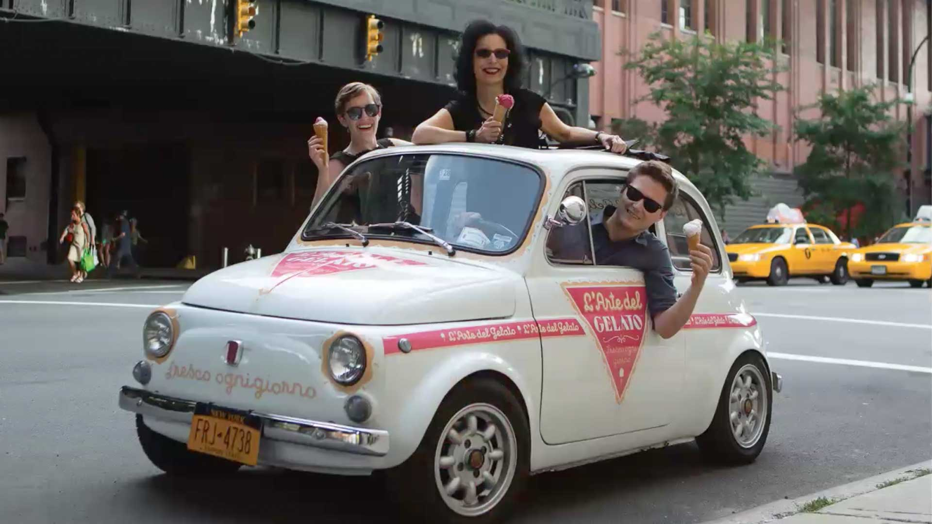 3 people in a small white car