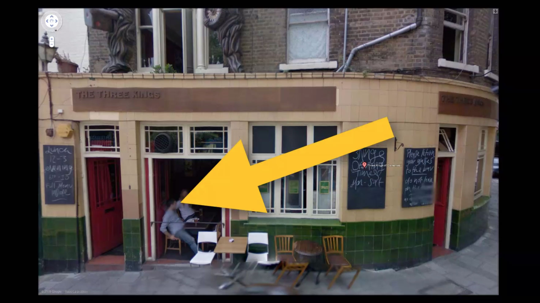 exterior of a pub with giant arrow poointing to Matt Willey