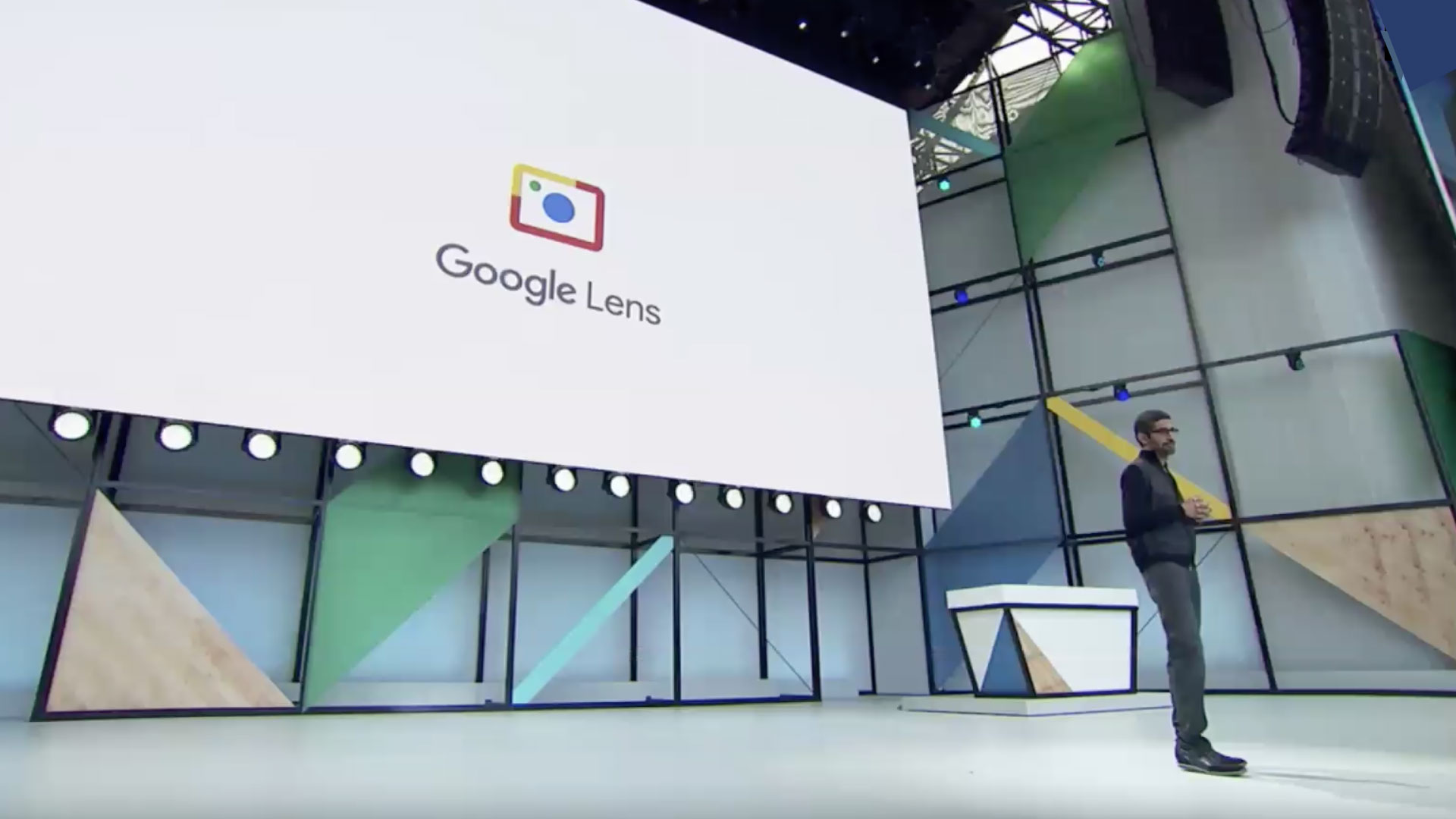 Robert Wong google lens branding with man on stage