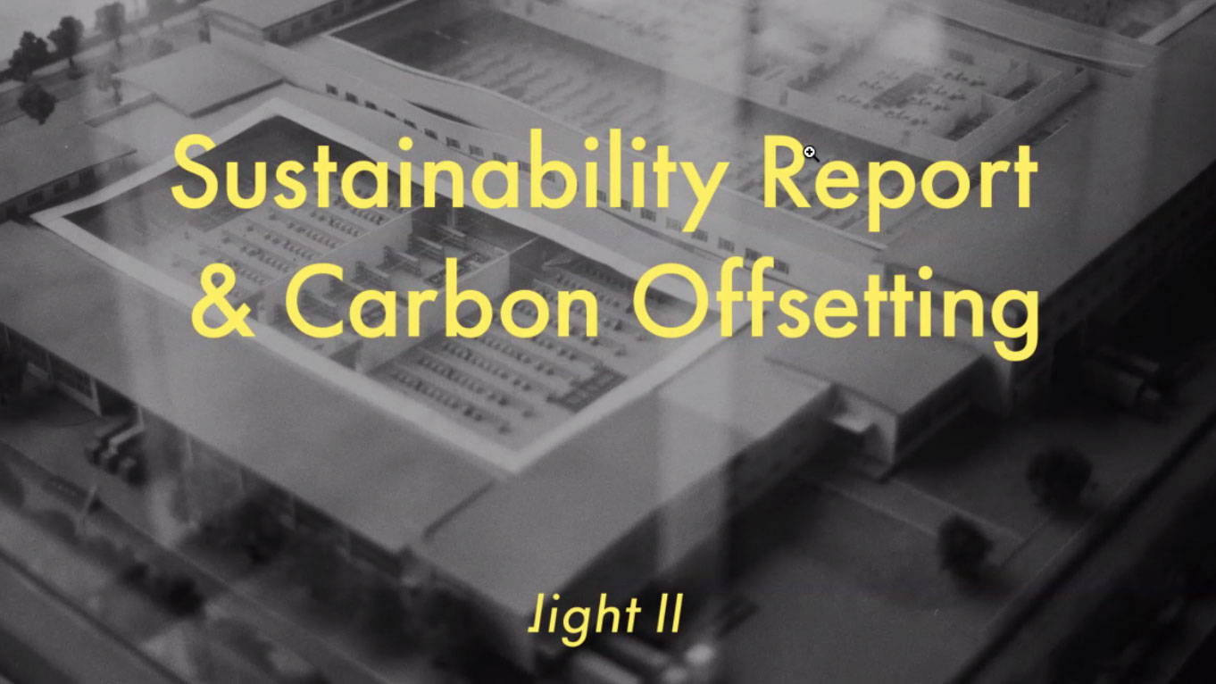 sustainability report ans carbon offsetting in yellow type over a black and white photo of a model building