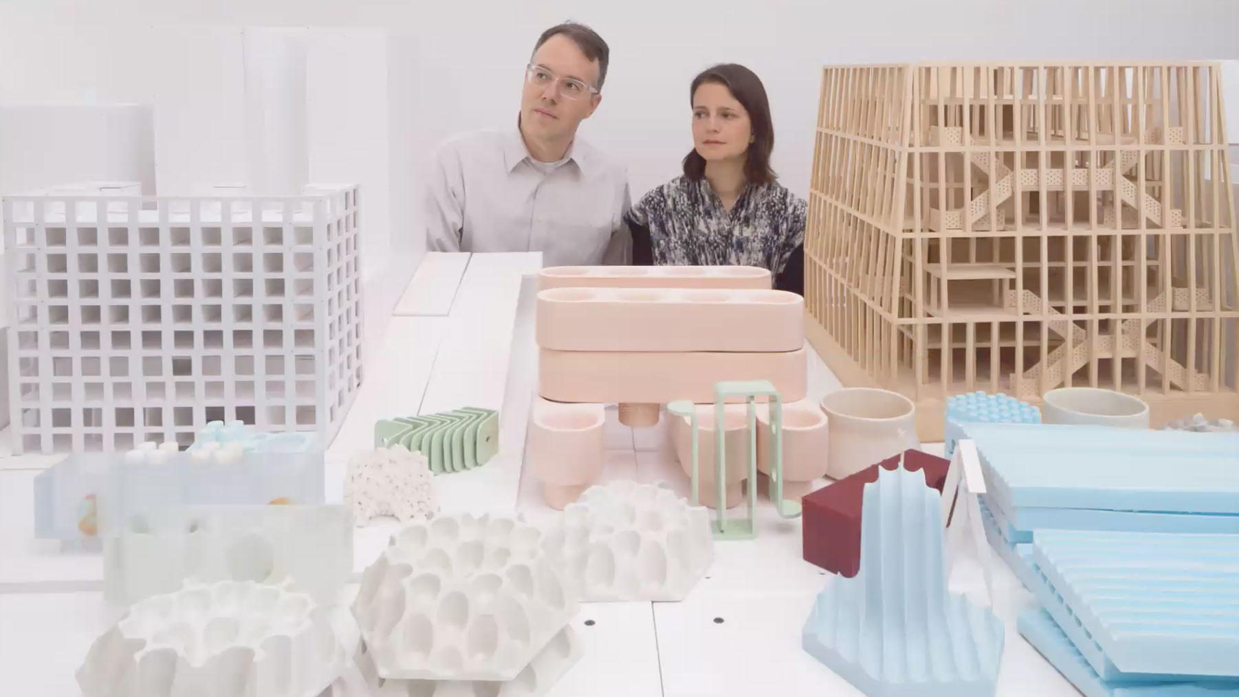 a man and a woman with architecture prototypes